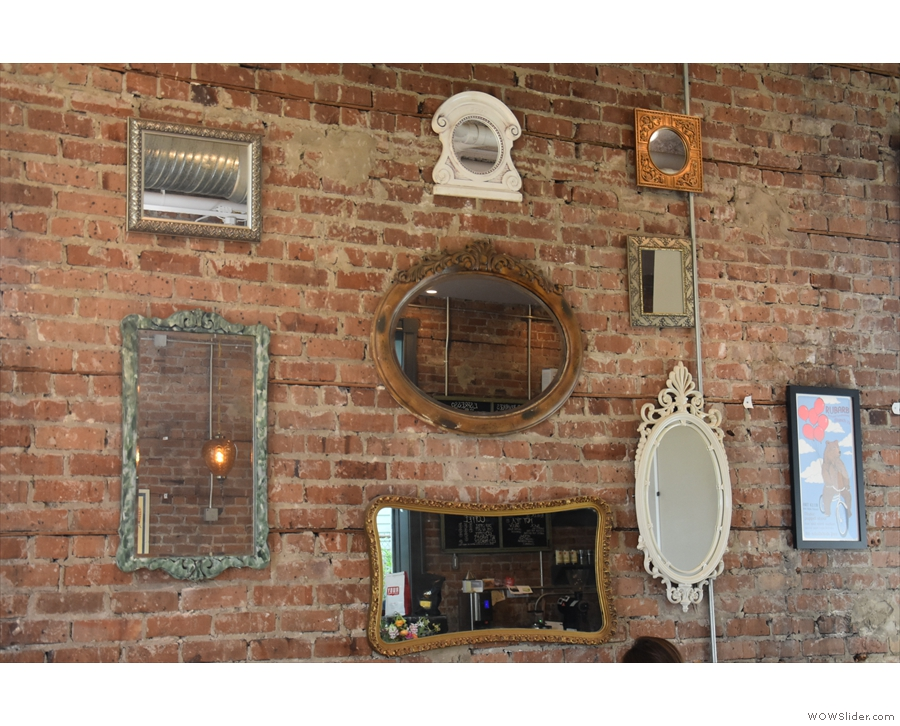 ... hung with various mirrors and a solitary picture.