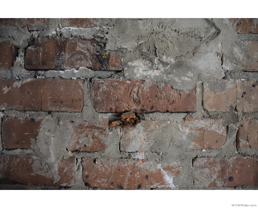 Meanwhile an old wooden beam end in the wall hints at long-gone internal structures.