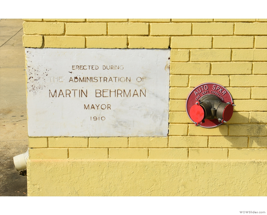 This plaque on the corner gives something of the building's history.