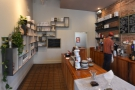 There's a kitchen at the back, through the open doorway, while retail shelves...