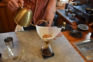 The kettle is moved around over the surface of the coffee...
