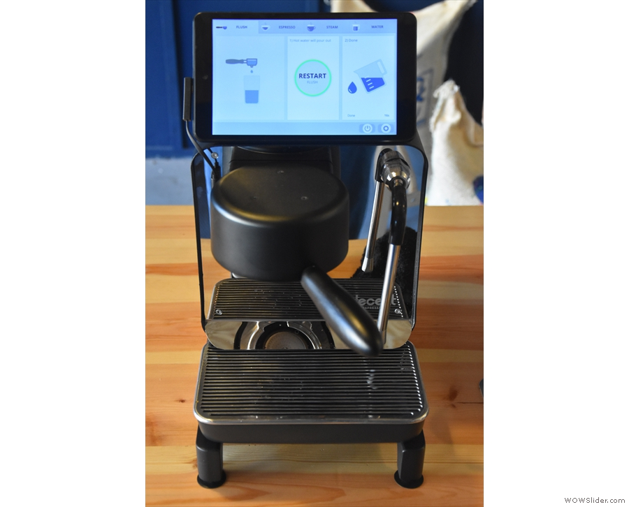 Attach the portfilter, using the neat handle to steady the machine, and we're ready.