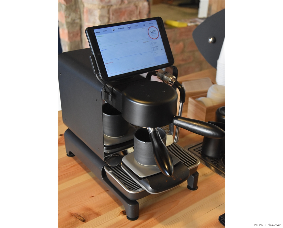 Attach the portafilter, slide the scales and cup into position, and off we go.