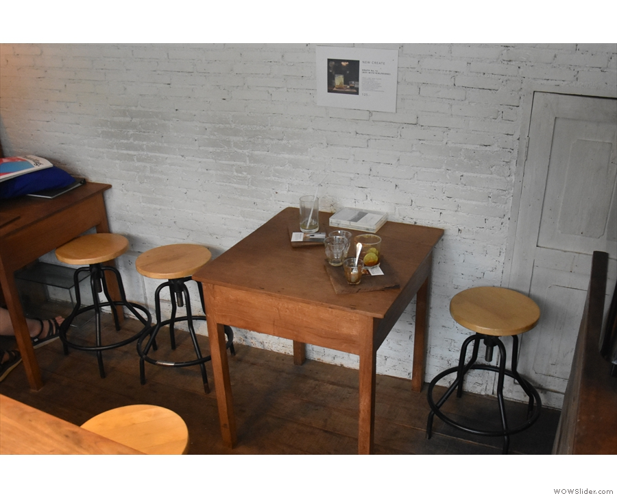 ... and a pair of two-person tables against the back wall.