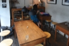 ... while the seating is at the other end. There's a communal table at the front...