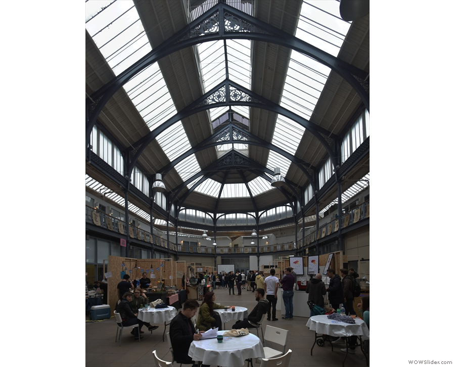 Once inside, you are greeted by the soaring glass roof of the main hall.