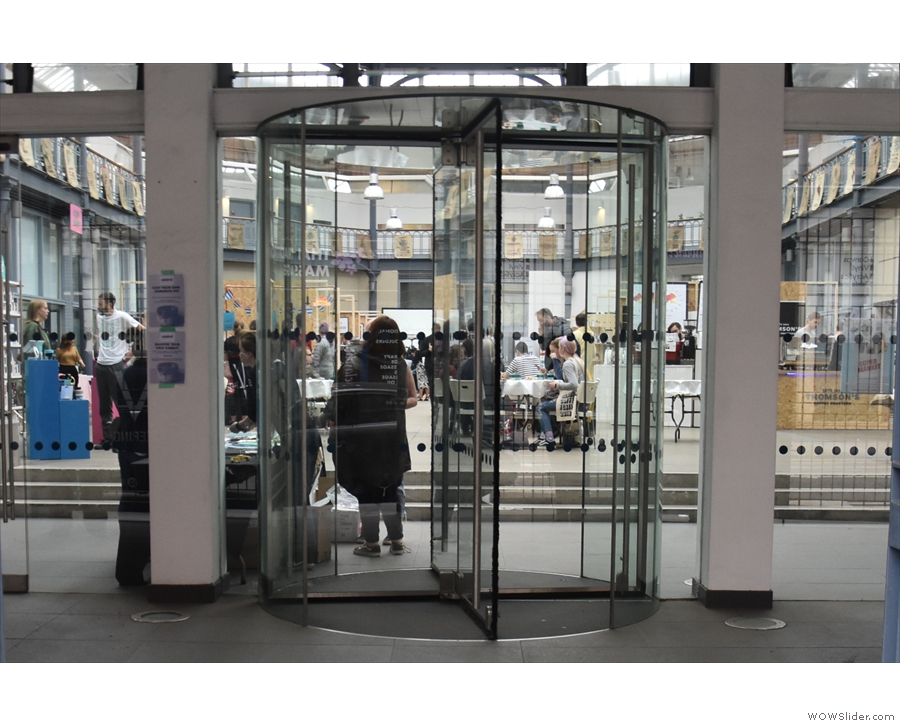 These revolving doors at the back might look like the way in, but the entrance is to the left.