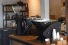 ... followed at the far end by the espresso machine and its grinder.