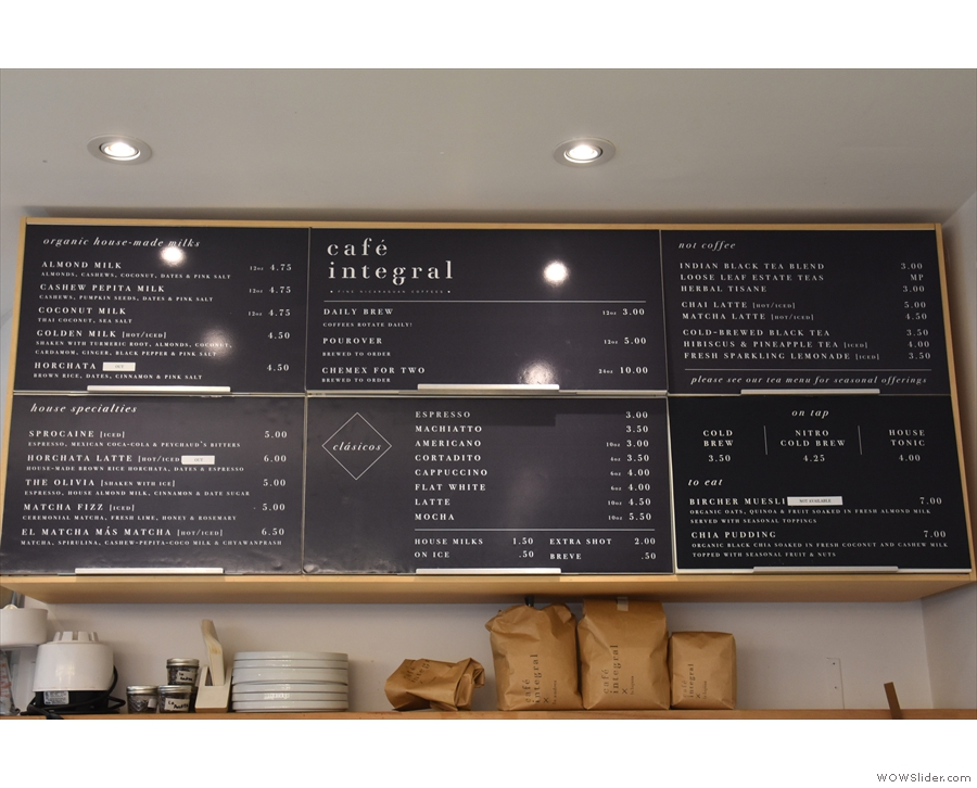 The main menu, with prices, is on the wall above/behind the counter.