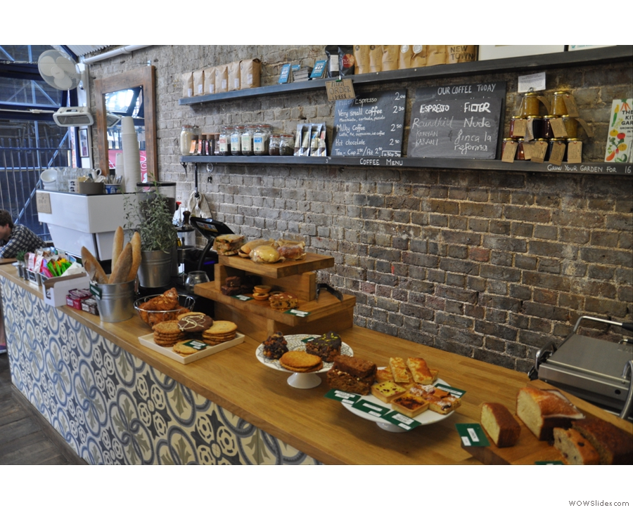 The counter. Lovely tiles in front, lovely bare brick behind. Cake on top!