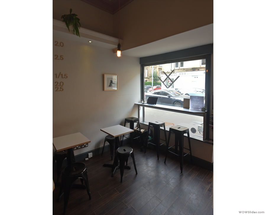 There are two two-person tables against the right-hand wall.