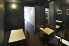 The view from the back of the back room. The mirror on the wall makes it feel bigger.