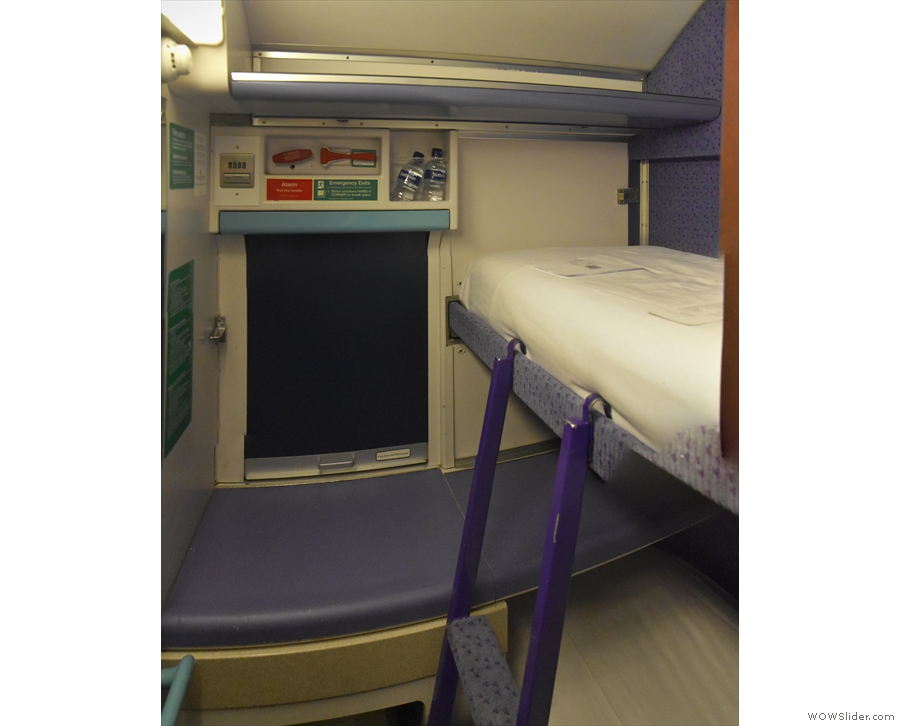 Meanwhile, the top bunk is accessed by a moveable ladder, normally at the far end.