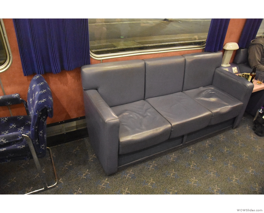 On board, and the first stop is the lounge car. Where else can you find sofas on a train?