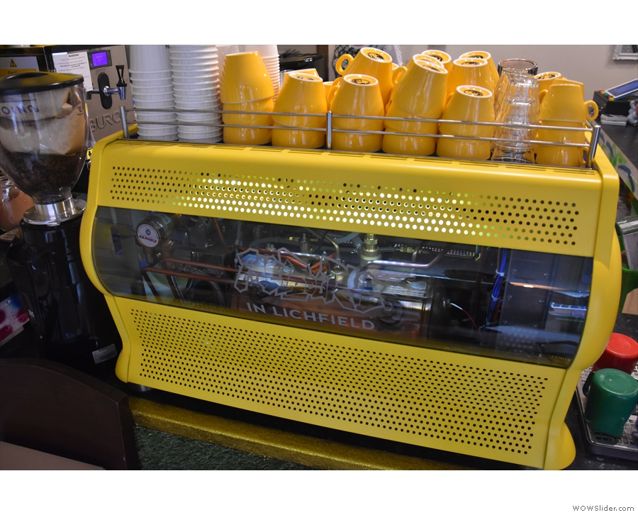 ... with this gorgeous, yellow, bespoke Conti espresso machine with a cut-away panel.