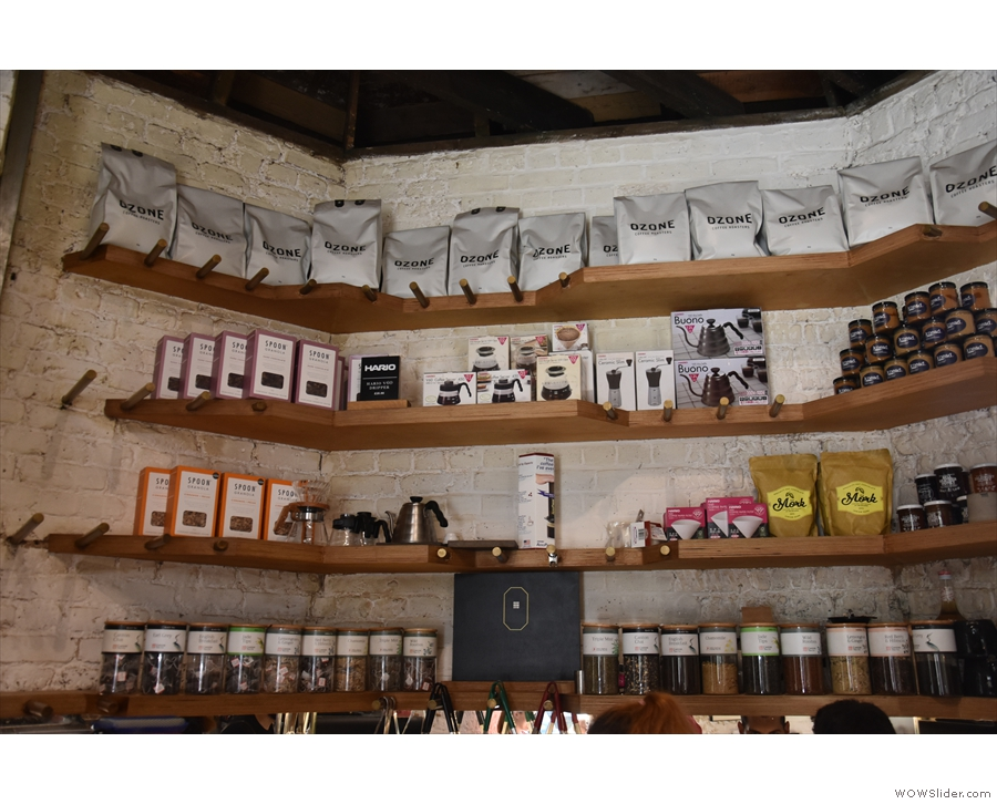 There is more coffee, and coffee kit, on the walls behind the counter.