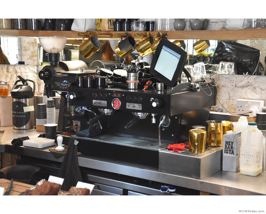 The espresso machine dispenses shot of Ozone's Empire Blend...