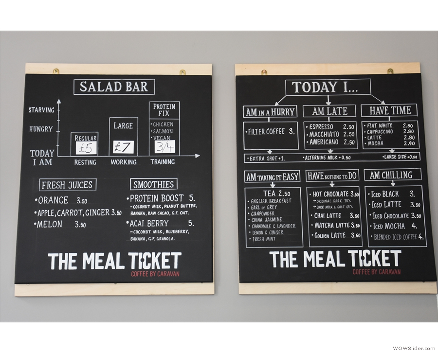 The drinks menu is joined on the wall by the menu for the salad bar...