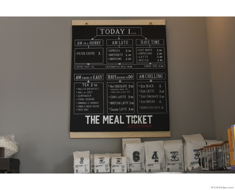 A handy flow-chart menu on the wall behind helps you order your coffee and other drinks.