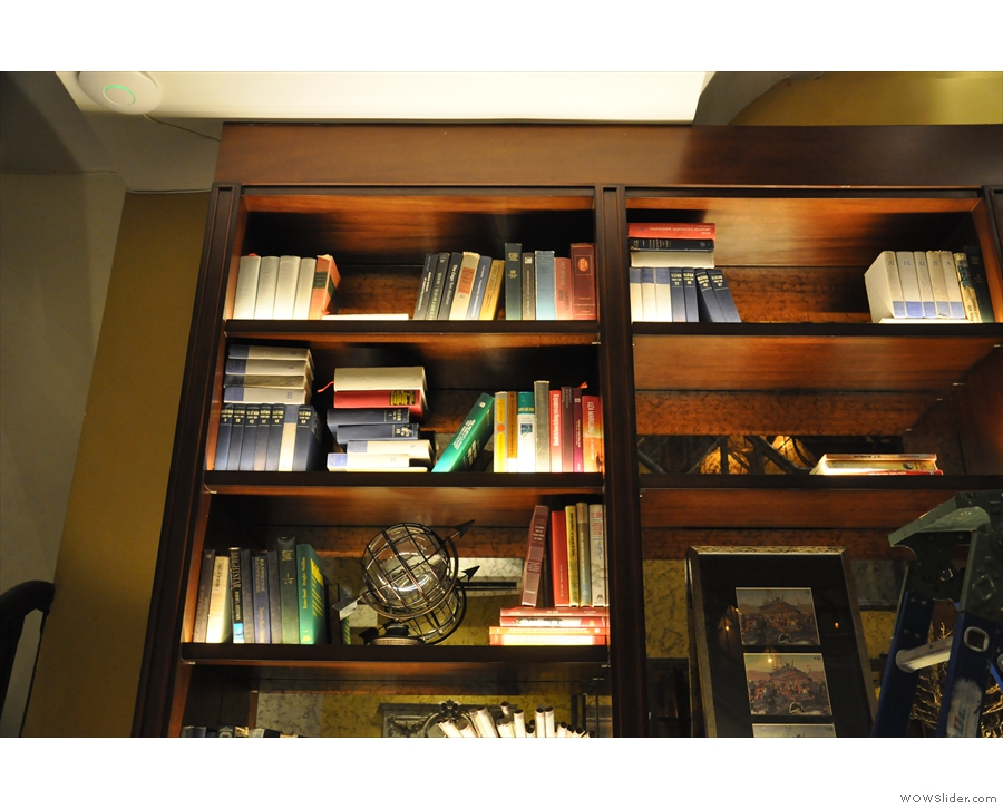 The back room downstairs has a set of bookshelves on the left-hand wall.