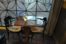 One of the tables at the back, by the frosted window.