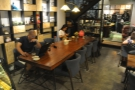 There's also an eight-person communal table on the left beyond the counter.