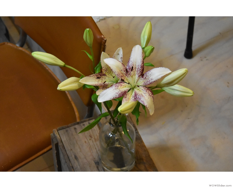 There are flowers on various tables as welll...