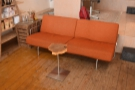 ... and, facing that, a big, orange sofa.