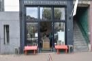 In western Amsterdam, on Bilderdijkstraat, stands a modest store front...