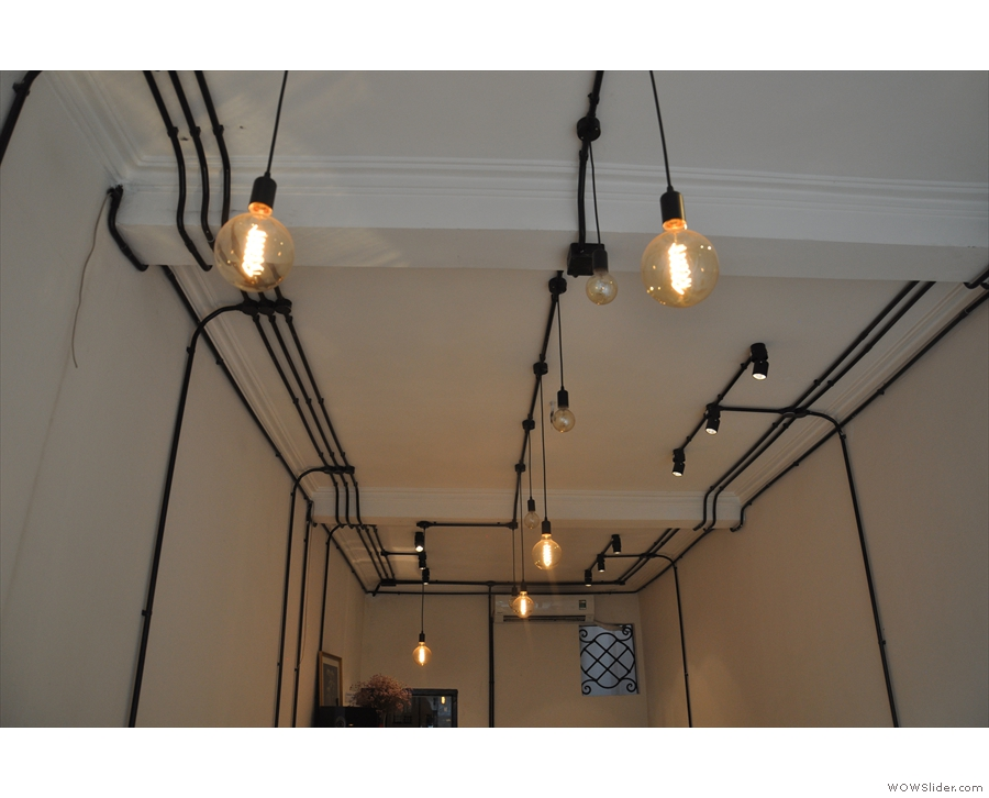 While there's plenty of natural light, there are also the obligatory bare bulbs...