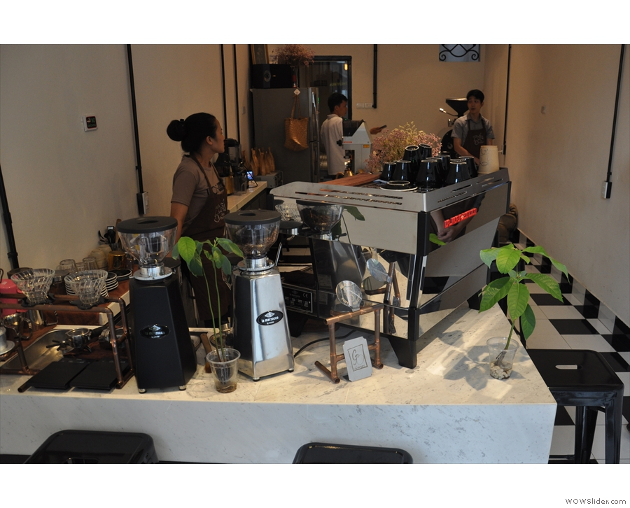 You can sit at the front of the counter and although you're by the espresso machine...