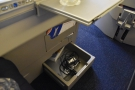Back to my seat and there's a neat storage draw under the table. And a US power socket.