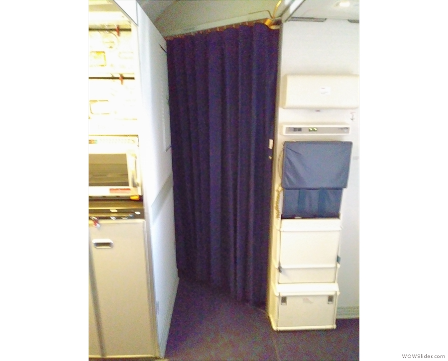 ... which is screened off by a curtain during flight.