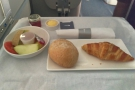 Half an hour later, breakfast was served, starting with bread and fruit.