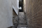 ... beyond which a narrow staircase between buildings leads up to Saddler Street...