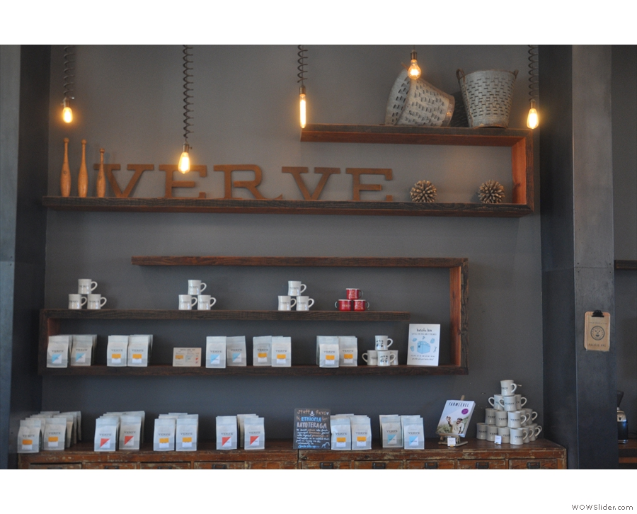 The front wall, other than the table by the Pacific Avenue door, holds retail shelves.