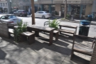 The view from the window, including the outside seating area on Pacific Avenue.