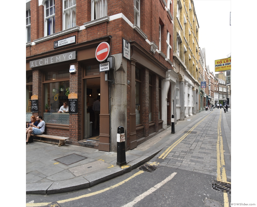 On the corner of Ludgate Broadway & Carter Lane, stands the Alchemy Cafe.