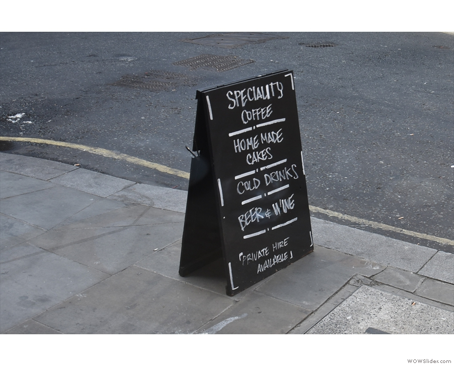 ... while the A-board cuts a solitary figure on the veritable expanse of pavement.