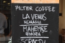 The filter coffee options are chalked up on a board by the door...