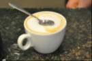My second visit was more coffee-focused. Here a cappucino (not mine) is put to the spoon test. It passed, with flying colours!