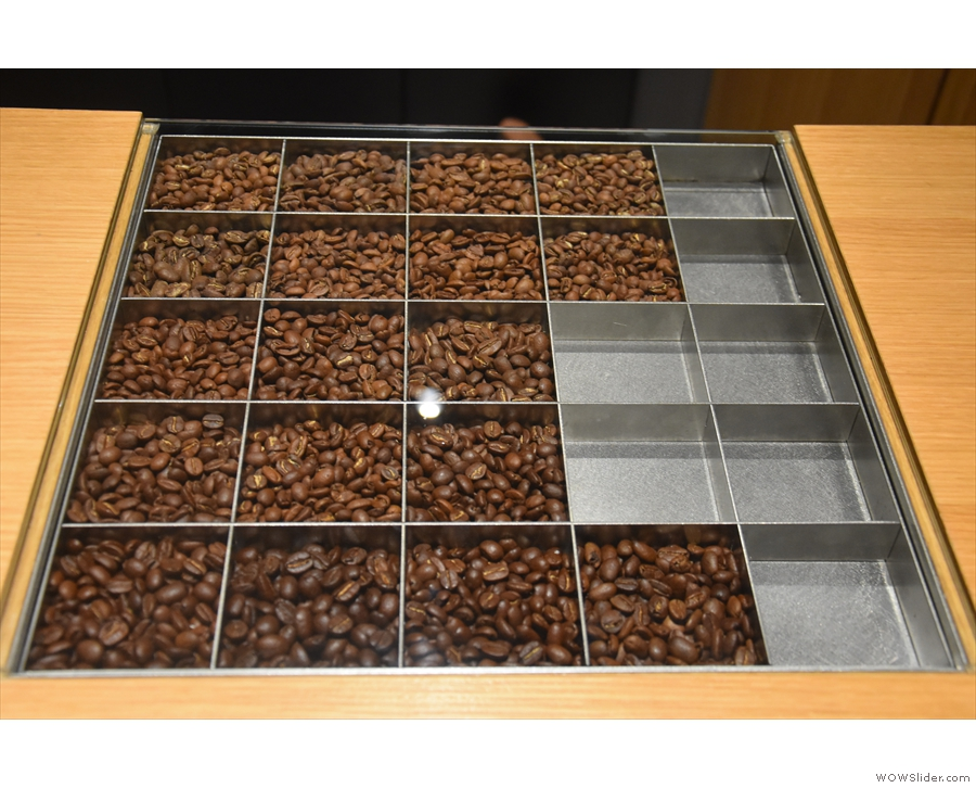 The beans are arranged in bins by roast profile, getting darker the further down you go.