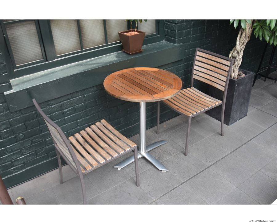 ... such as this shaded two-person table to the left.
