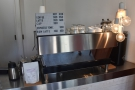 ... with a counter at the back, espresso machine on the right.