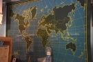 Meanwhile, a map on the wall behind the counter shows where the coffee is from.