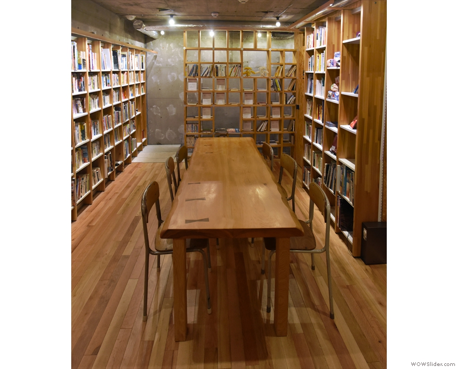 ... seen here from another angle. I love the wooden floor and bookshelves up here.