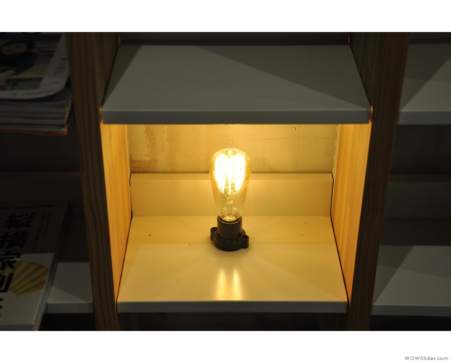 The shelves opposite also have a light-bulb in a box...
