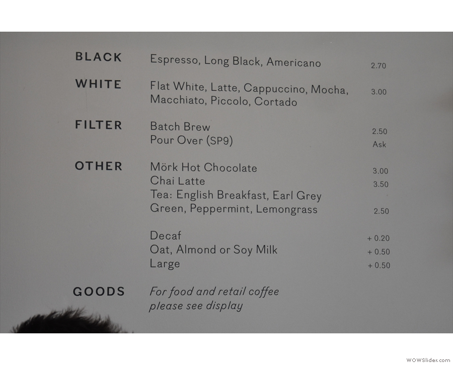 The concise coffee menu is on the wall behind the till...