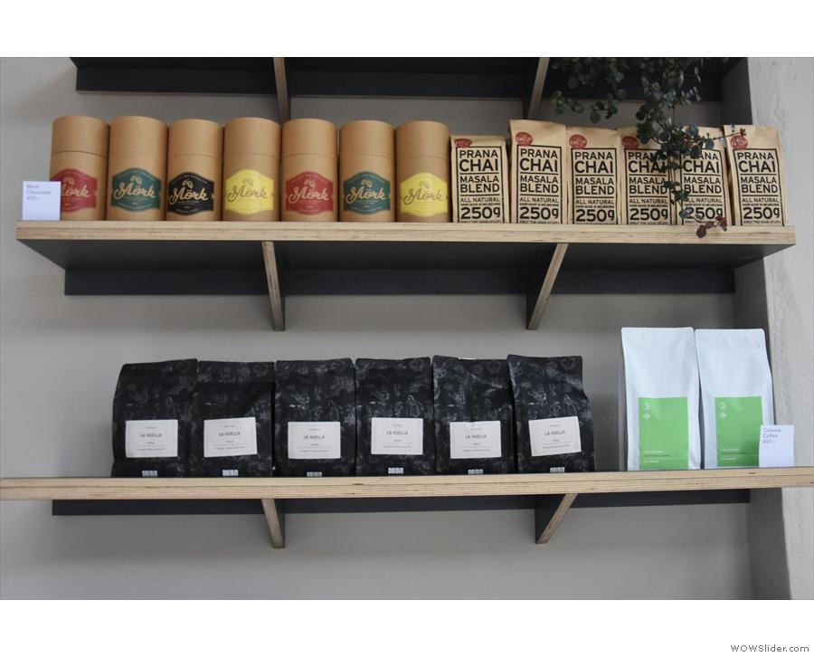 The top shelf has hot chocolate from Australia, plus chai, while the shelf below...
