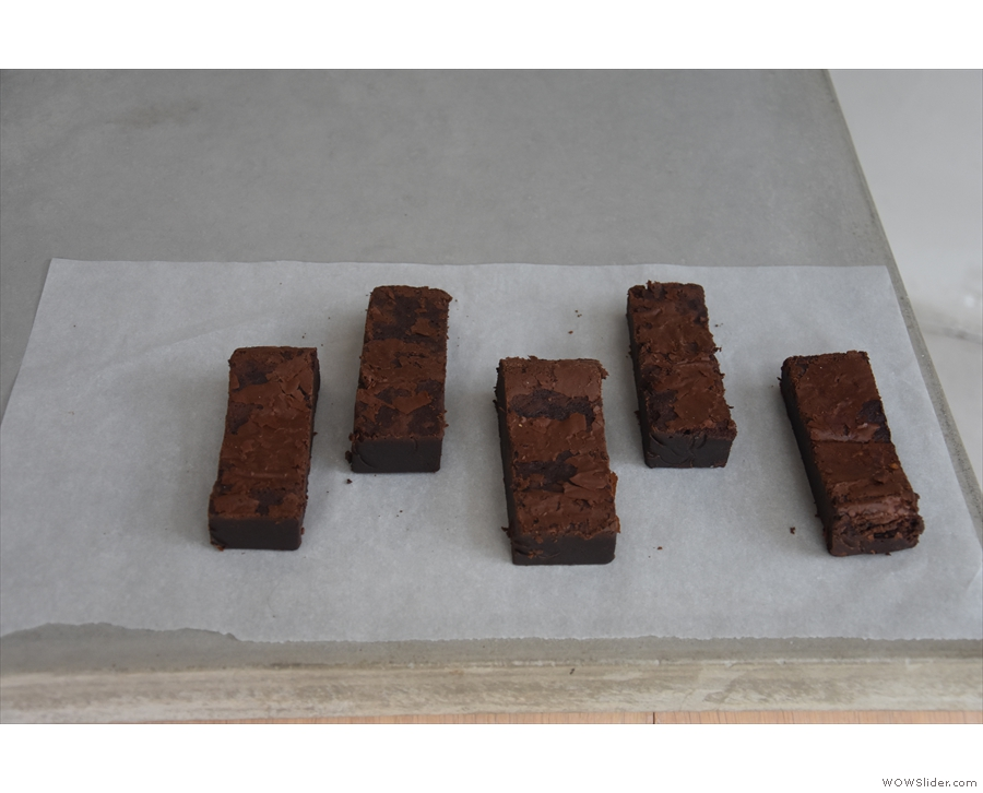 ... while the cakes, chocolate brownies in this case, are laid out on the counter.